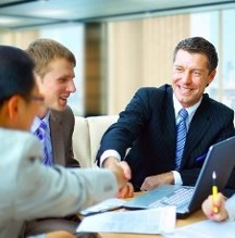 Businessmen Shaking Hands - Marketing Services